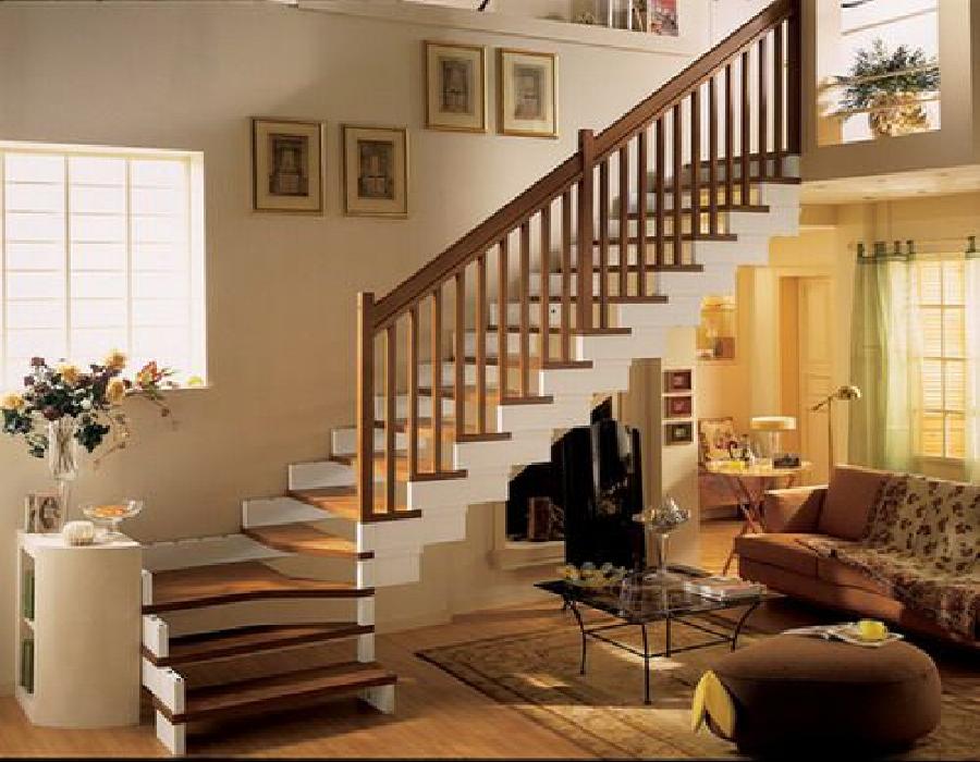 Cầu thang hình chữ L tạo điểm nhấn cho ngôi nhà.